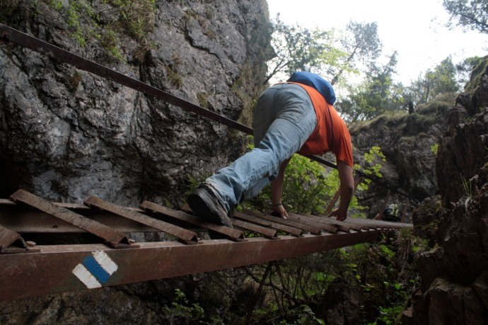 Crossing the gorge by ladder.