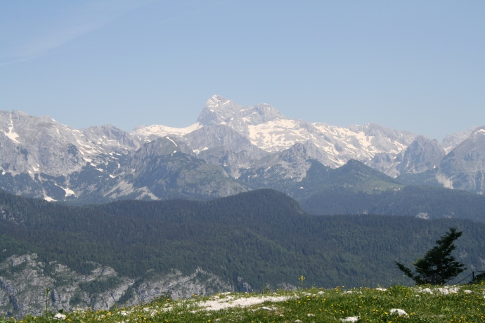 Triglav, Slovenia's highest peak, shows itself across the valley.